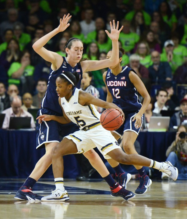 Irish guard Lindsay Allen tries to get around Huskies junior forward Breana Stewart during Notre Dame's 76-58 loss to Connecticut on Saturday at Purcell Pavilion.