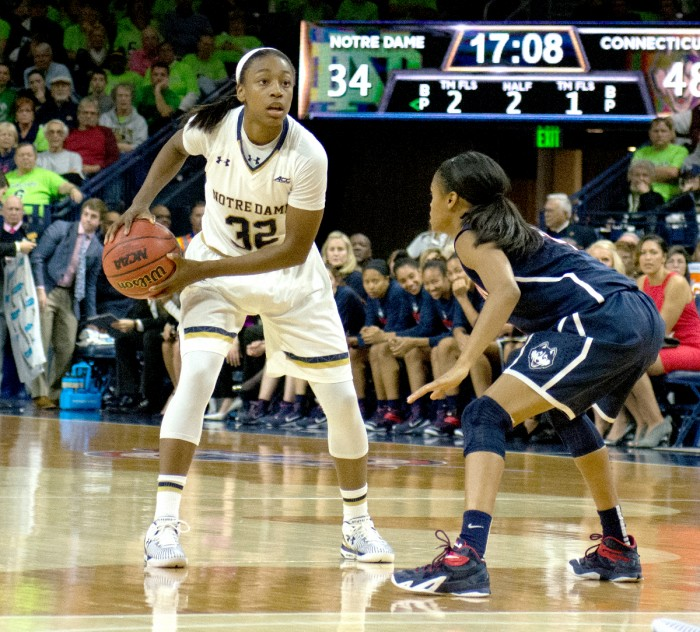 Irish junior guard Jewell Loyd scans the court during Saturday's 76-58 loss to Connecticut in the Purcell Pavilion. Loyd tied her career high with 31 points against the Huskies.