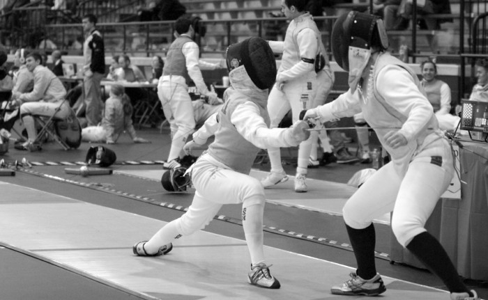 Notre Dame junior foil Sarah Followill lunges during the Decicco Duals in February at the Castellan Family Fencing Center.