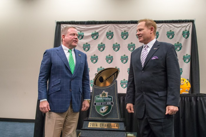 Notre Dame head coach Brian Kelly and LSU head coach Les Miles talk before a joint press conference Monday afternoon at LP Field in Nashville, Tennessee. Notre Dame and LSU will meet in The Franklin American Mortgage Music City Bowl on Tuesday afternoon.