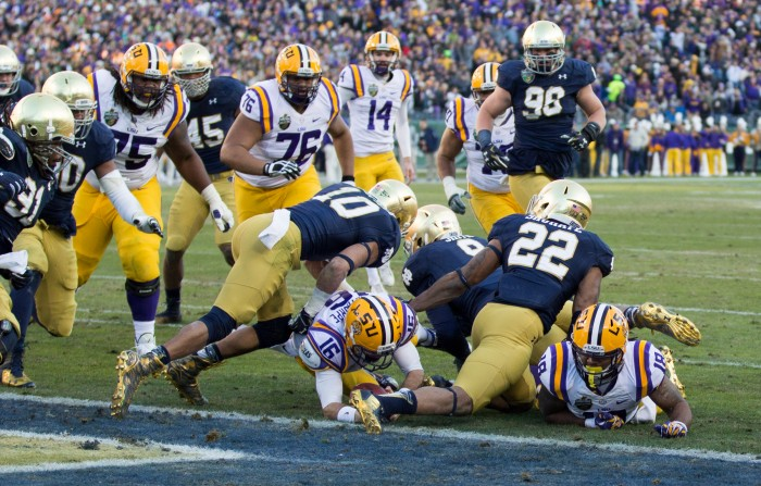 The Irish defense stops Tigers junior quarterback Brad Kragthorpe just short of the end zone following a fake field-goal attempt in the second quarter.