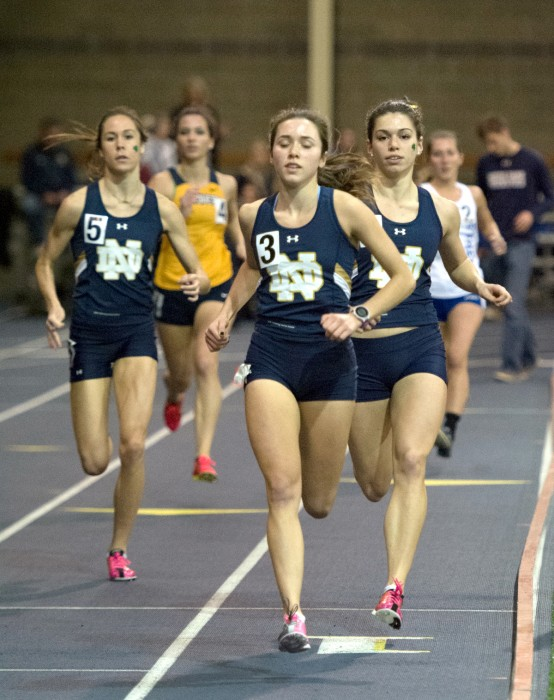 Irish freshman Ashlyn Rambo, left, junior Danielle Aragon, center, and freshman Jessica Harris compete in the 1,000-meter run during the Blue and Gold Invitational on Dec. 5 at Loftus Sports Center.