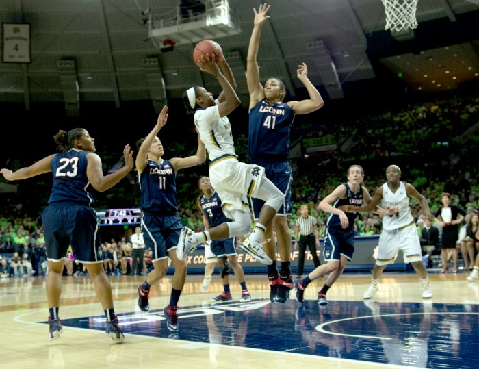 Irish junior guard Jewell Loyd shoots a layup during Notre Dame's 76-58 loss to Connecticut on Dec. 6 at Purcell Pavilion.