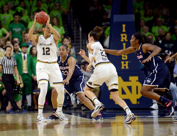 Irish sophomore forward Taya Reimer sets up to pass during Notre Dame's 76-58 loss against Connecticut on Dec. 6 at Purcell Pavilion.