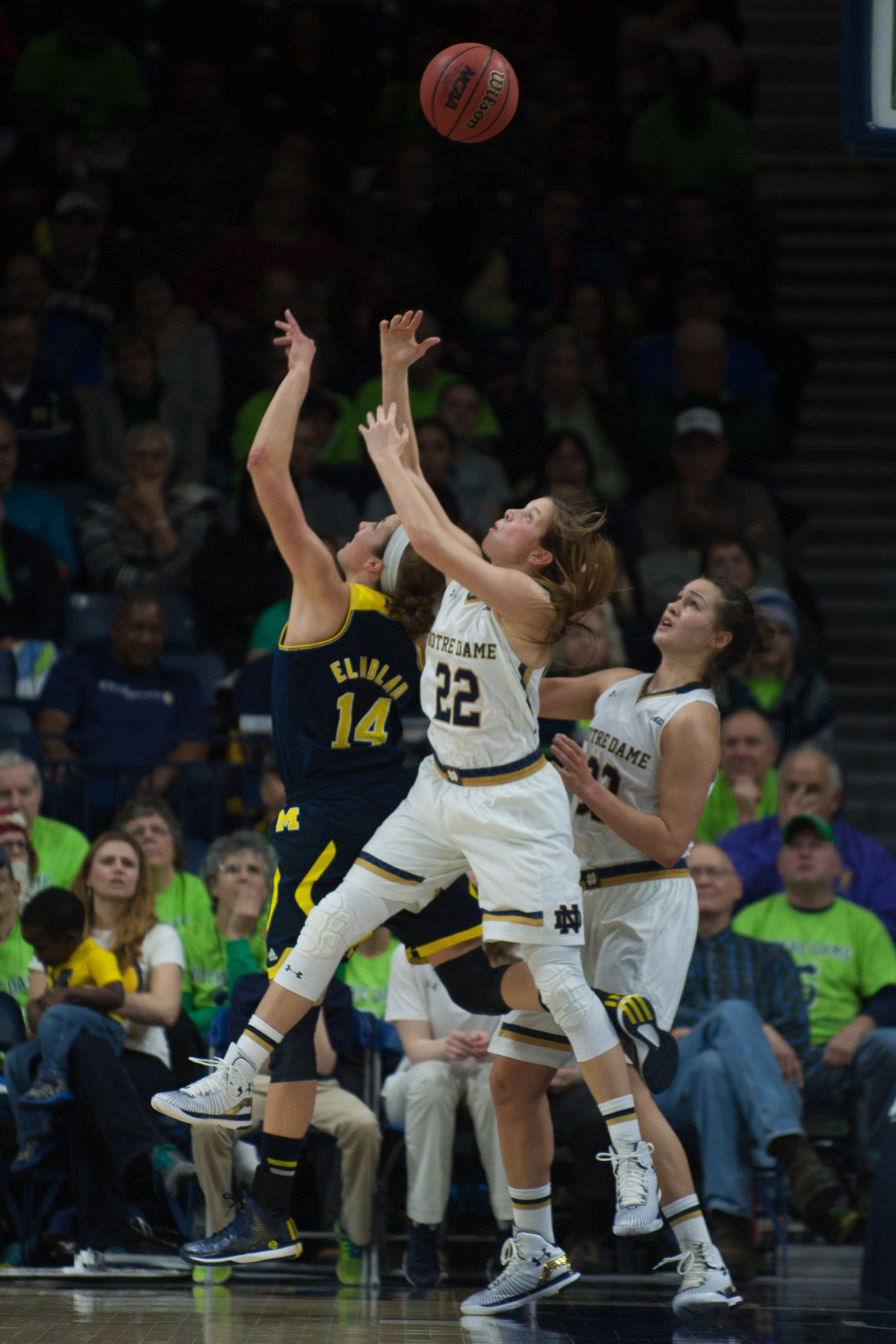 Irish senior guard Madison Cable leaps for a rebound during a 70-50 win over Michigan on Dec. 13 at Purcell Pavilion.