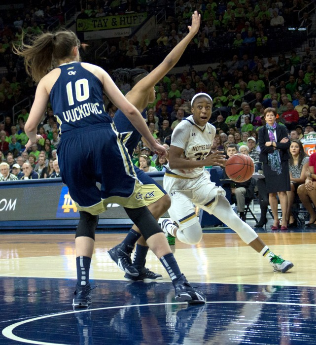Irish junior guard Jewell Loyd drives against two Georgia Tech defenders during Notre Dame's 89-76 win Thursday at Purcell Pavilion.