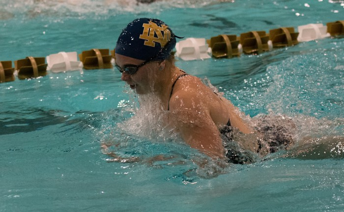 Irish junior Genevieve Bradford takes a breath before finishing third in 100-yard breaststroke during Notre Dame's meet against in-state rival Purdue on Nov. 1. The Irish dropped the dual meet at Rolfs Aquatic Center, 170-128.