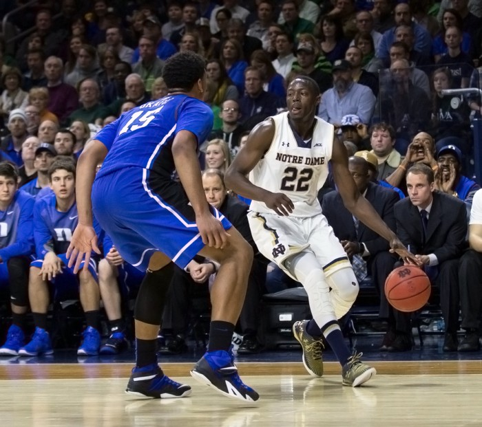 Irish senior guard Jerian Grant is guarded by Duke freshman center Jahlil Okafor during Notre Dame's 77-73 win at Purcell Pavilion on Wednesday. Both players recorded double-doubles.