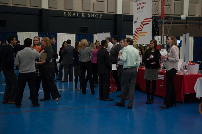 Students mingle with employers at the Career Center's winter career and internship fair. For this year's fair, Notre Dame hosted Deloitte, General Electric and others in the Joyce Center.