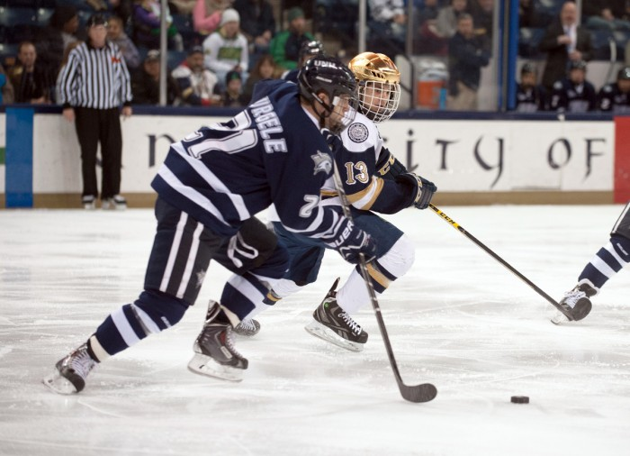 Irish sophomore center Vince Hinostroza battles for the puck during Notre Dame's 5-2 loss to New Hampshire on Friday.
