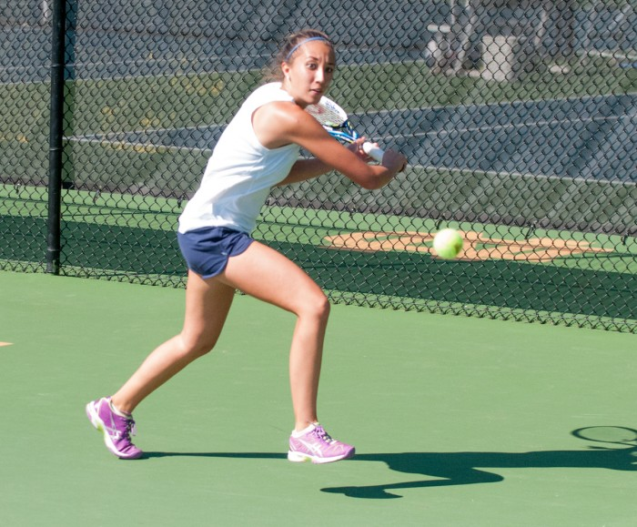 Irish junior Julie Vrabel prepares to unleash a shot during the Notre Dame Invitational on Sept. 26. Vrabel went 1-1 in doubles play on the day and lost her only singles match,