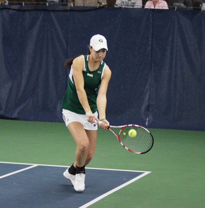 Notre Dame junior Quinn Gleason, who occasionally partnered with sophomore Jane Fennelly in doubles play in the past, volleys the ball during a 4-3 loss to Georgia Tech in Eck Tennis Center on Feb. 21, 2014.