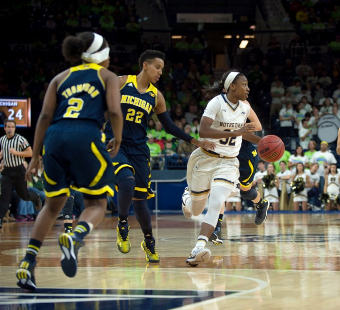 Irish junior guard Jewell Loyd looks for an open teammate during Notre Dame's 70-50 victory over rival Michigan on Dec. 13 at Purcell Pavilion. Loyd scored 14 points and pulled down 5 rebounds in the win.