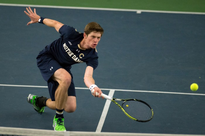 Junior Quentin Monaghan lunges for a shot during a 4-3 win against Oklahoma State at Eck Tennis Pavilion on Jan. 24.