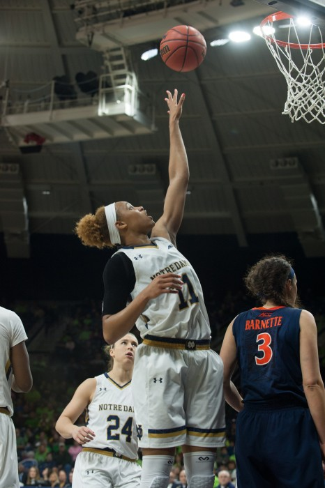 Irish freshman forward Brianna Turner skies for a loose ball after a foul during Notre Dame's 75-54 win over Virginia on Thursday.