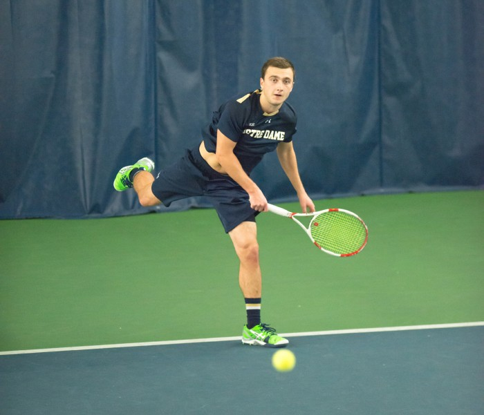 Irish sophomore Eddy Covalschi returns a shot during Notre Dame's 4-3 win over Oklahoma State on Jan. 24 at Eck Tennis Pavilion.