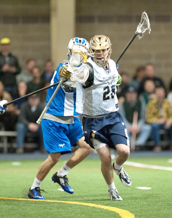 Irish senior attack Conor Doyle slips away from an Air Force defender during the two teams' exhibition Jan. 31.