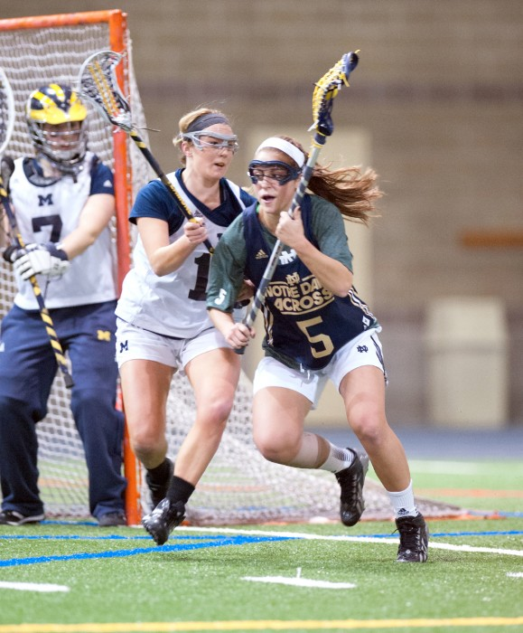 Irish junior attack Rachel Sexton works her way to the front of the net in Notre Dame's 19-7 exhibition win over Michigan on Feb. 8, 2014.