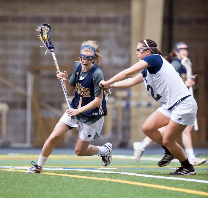 Irish junior attack Kiera McMullen skirts a Michigan defender during Notre Dame's 19-7 exhibition win over Michigan on Feb. 8, 2014, at Loftus Sports Center. McMullen scored 26 goals for the Irish last season.