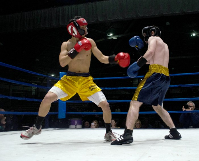 Andy Faustone (right) fights Jeffrey Wang in a round during last year's Bengal Bouts. The Bouts  benefit Holy Cross missions in Bangladesh.