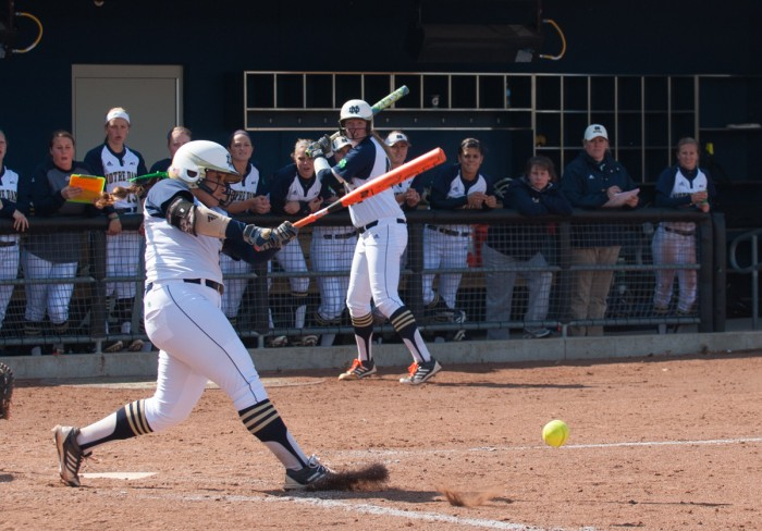 Notre Dame junior first baseman Micaela Arizmendi hits a pitch in a 12-4 win over Boston College on May 3 at Melissa Cook Stadium.