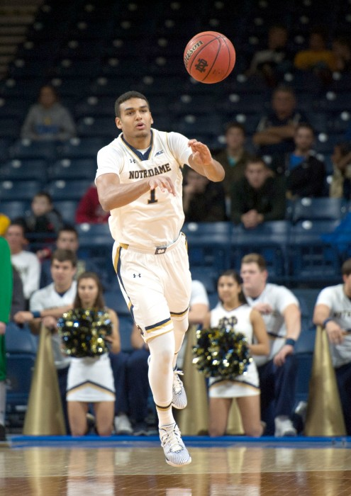 Irish sophomore forward Austin Torres passes downcourt during Notre Dame's 81-54 win over Grambling State on Nov. 26.