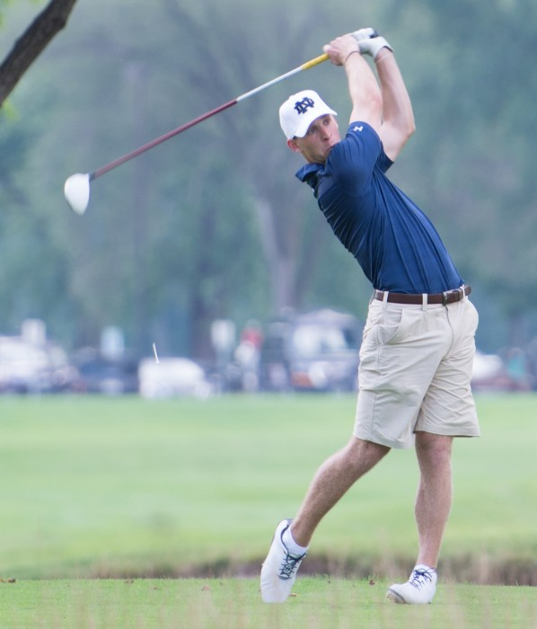 Senior Patrick Grahek follows through on a swing at the Notre Dame Kickoff Challenge on Aug. 31 at Warren Golf Course.