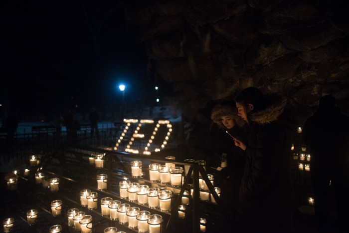 Candles illuminate The Grotto in memory of Fr. Theodore Hesburgh, who died Thursday at 97.