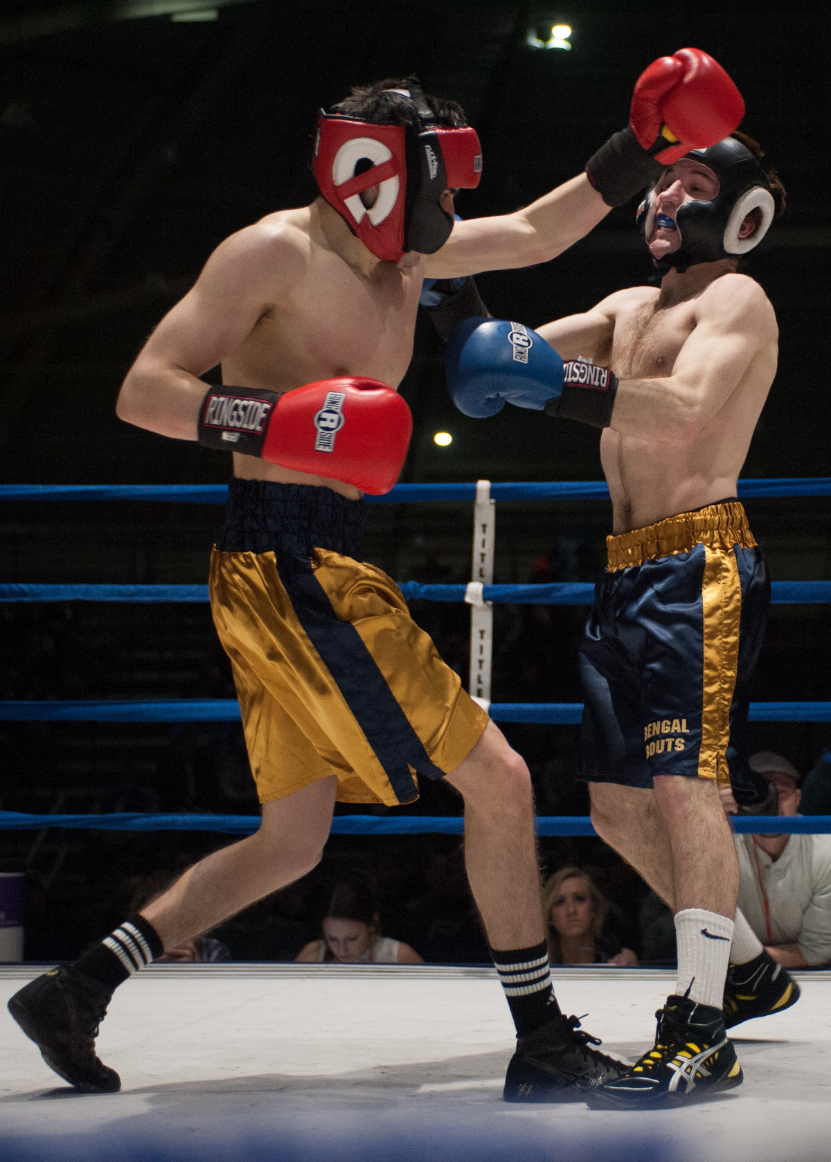 Senior Chris Tricario, right, fights during the 2014 Bengal Bouts at Joyce Fieldhouse. Tricario was unable to participate in this year's competition due to an injury but remained involved in Bengal Bouts.