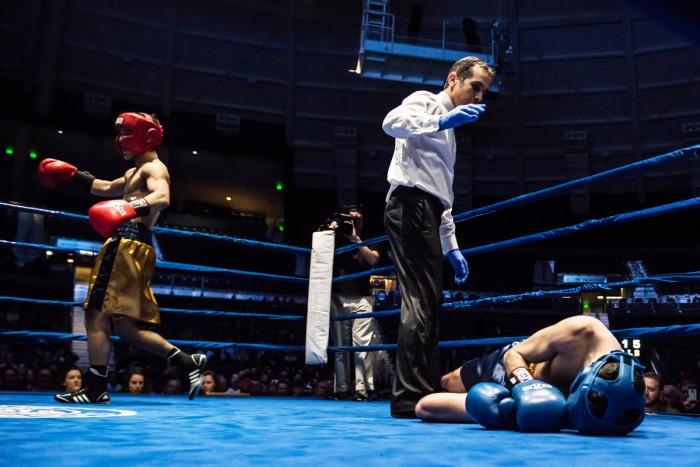 "Alex ""El Cadejo"" Alcantara (gold) celebrates his 135-pound final victory over Patrick ""il Lupo"" Brennan."