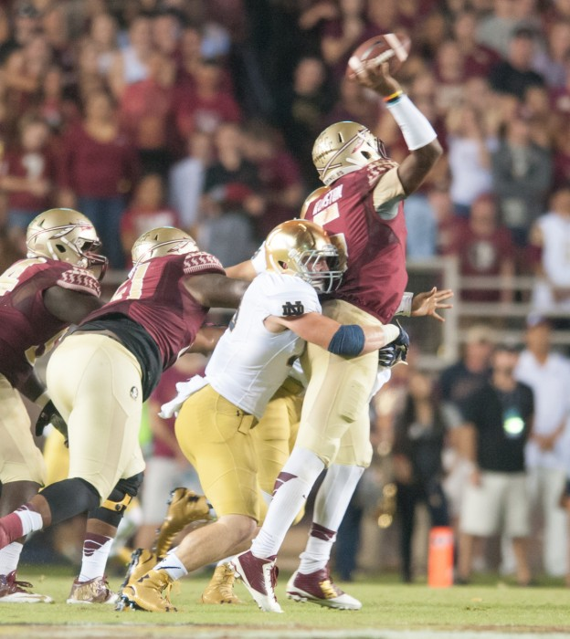 Senior Joe Schmidt gets a hit on Seminole sophomore quarterback Jameis Winston during Notre Dame's 31-27 loss against Florida State University on Oct. 18 at the Doak Cambell Stadium.