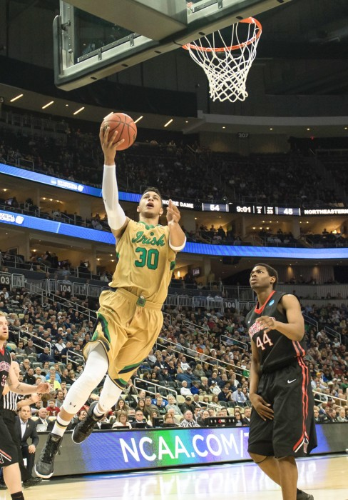 Irish junior forward Zach Auguste takes a shot during Notre Dame's 69-65 victory over Northeastern on March 19 at CONSOL Energy Center in PIttsburgh.