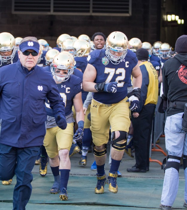 Graduate student center Nick Martin, 72, leads Notre Dame out of the tunnel before its 31-28 win in the Music City Bowl on Dec. 30.