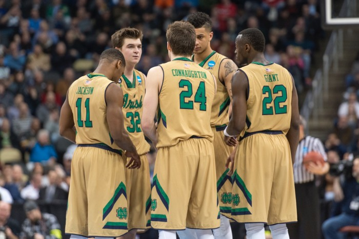 The Irish starters — from left , sophomores Demetrius Jackson and Steve Vasturia, senior Pat Connaughton, junior Zach Auguste and senior Jerian Grant — huddle March 19 during a 69-65 win over Northeastern.