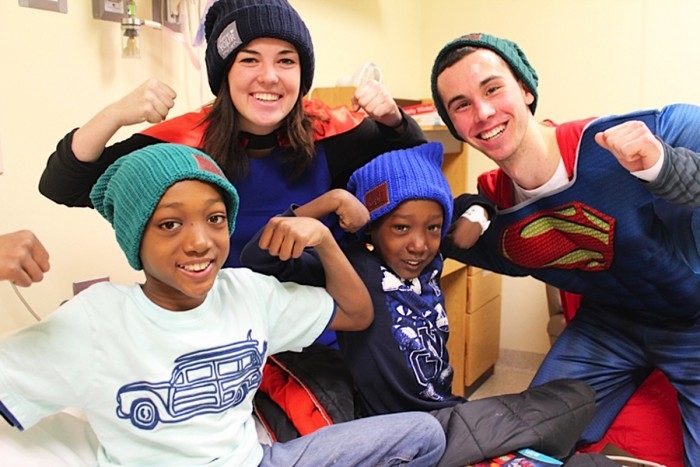 Notre Dame students visit Memorial Hospital in South Bend to give hats to children battling cancer and their families on March 18.