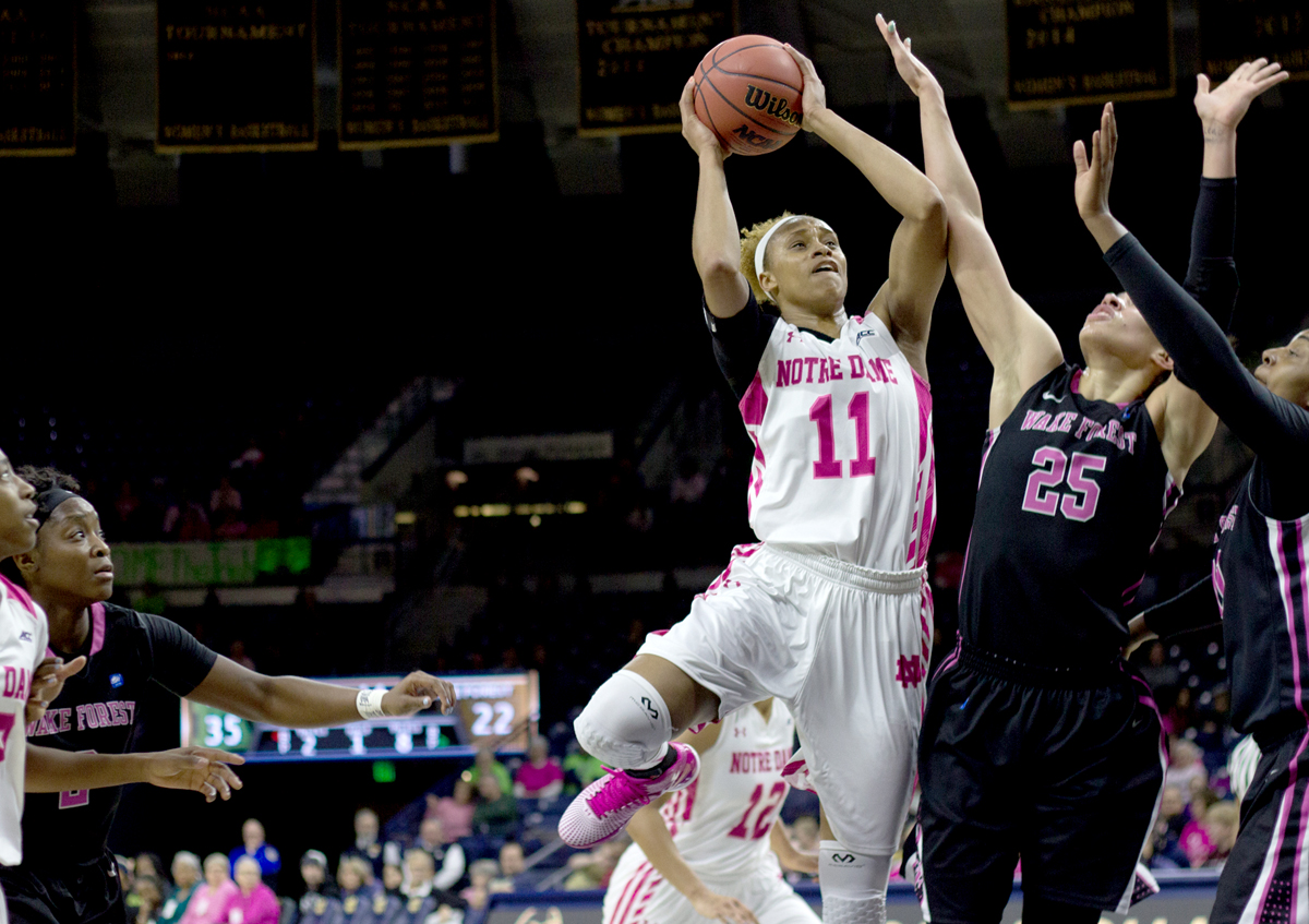 Notre Dame freshman forward Brianna Turner leaps to fire a contested shot over Wake Forest senior forward Dearica Hamby during a 92-63 Irish home victory over the Demon Deacons on Feb. 1.