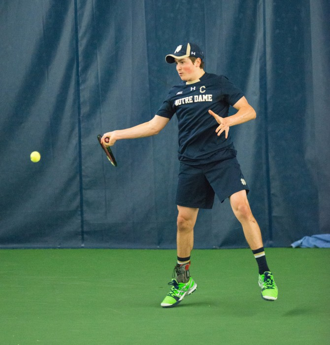 Junior captain Quentin Monaghan looks to hit a forehand during a 4-3 win over Oklahoma State on Jan. 21.