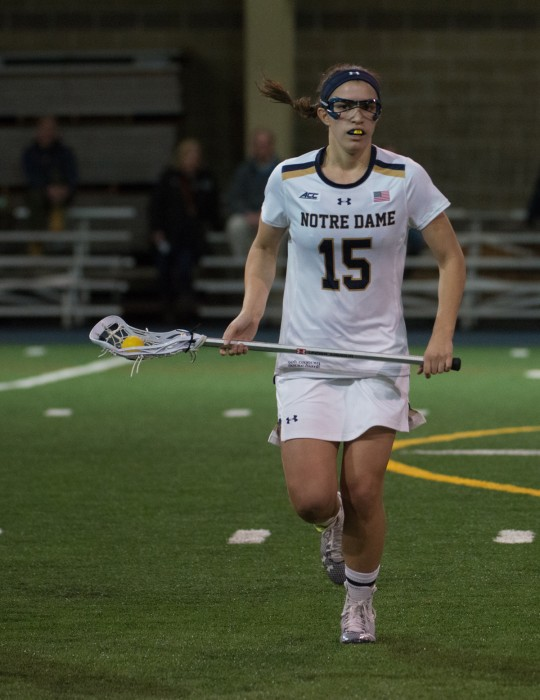 Sophomore Cortney Fortunato cradles the ball down the field during a 17-5 win against Detroit on Feb. 15.