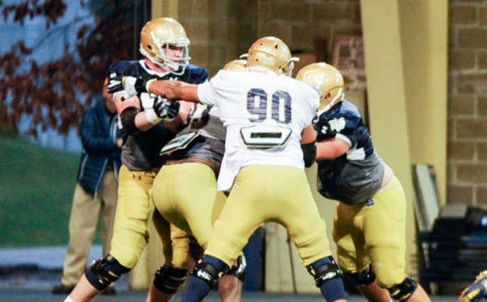 Irish junior defensive end Isaac Rochell particpates in a drill during an April 8 spring practice. Rochell  finished the 2014 season tied for second on the team with seven and a half tackles for loss.