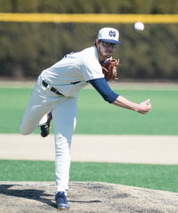 Senior pitcher Scott Kerrigan throws a pitch in a 4-2 loss to  Virginia on Mar. 28 at Frank Eck Stadium.