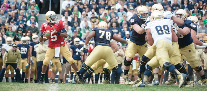 Quarterback Everett Golson, pictured in red, looks to pass during last year's Blue-Gold  Game.   Saturday, members of the football team will compete in a friendly match-up in preparation for their 2015 season.