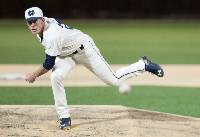 Senior Robert Youngdahl fires a pitch against Central Michigan on March 18 . The Irish won the game, 8-3.
