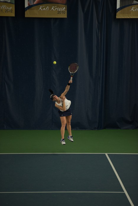 Irish freshman Allison Miller serves  during Notre Dame's 6-1 loss to Stanford on Feb. 6 at Eck Tennis Pavilion.