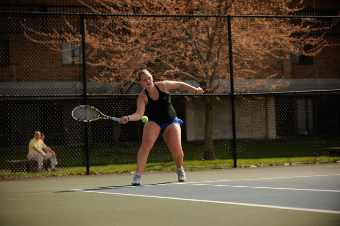 Belles sophomore Sam Setterblad returns a serve during Saint Mary's 8-1 win over Adrian on April 14 at Saint Mary's Tennis Courts.