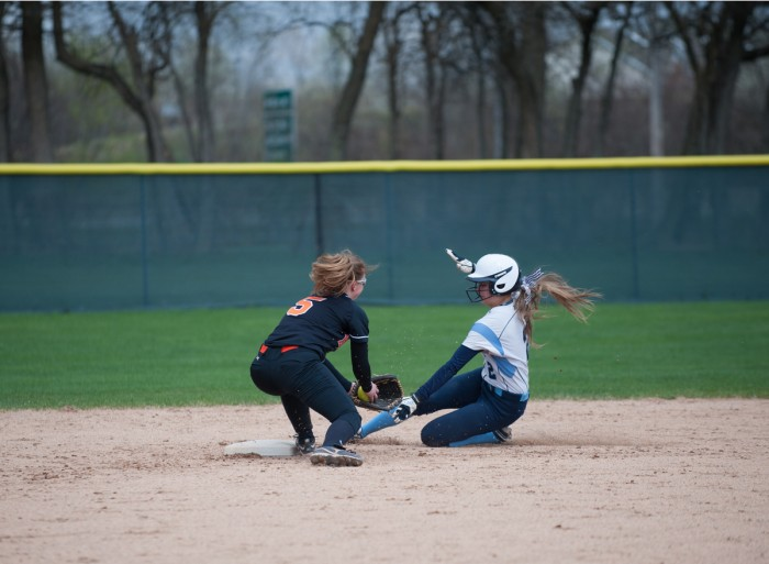 Belles freshman shortstop/second baseman Jamie Young slides into second base in Saint Mary's 9-6 win over Kalamazoo yesterday.