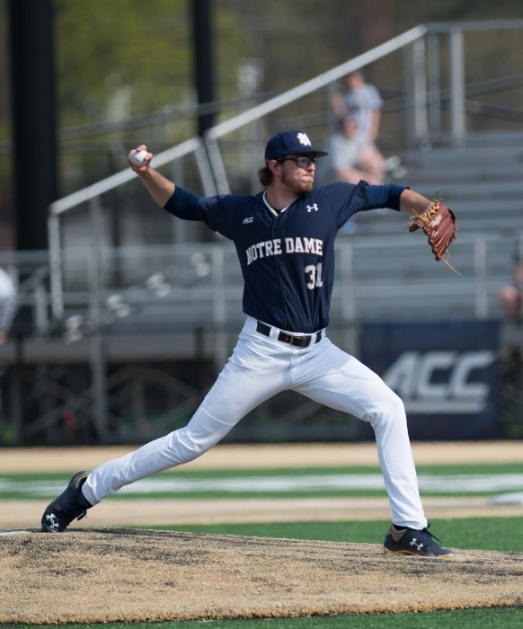 Senior right-hander Scott Kerrigan moves towards home during Notre Dame's loss 4-2 to North Carolina State on Sunday.