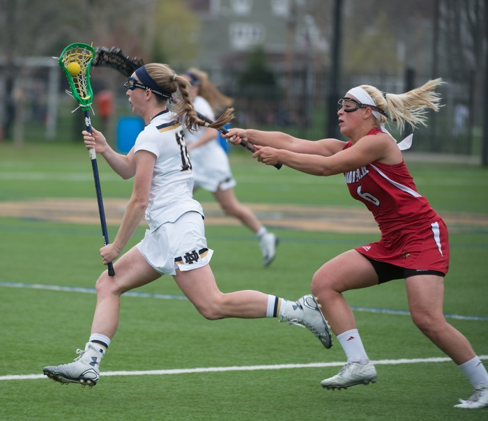 Sophomore midfielder Alex Dalton protects the ball from a Louisville defender in a 10-8 loss Sunday.