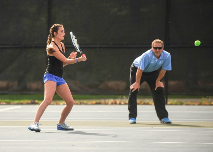 Belles junior Margaret Feller readies for a return from Adrian's Justine Hanson on April 14. Feller won 6-1, 6-0.