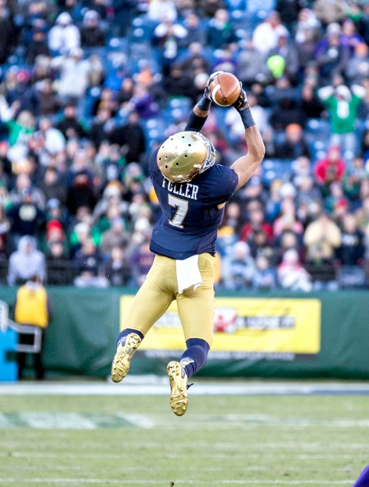 Irish sophomore receiver Will Fuller goes airborne to snag a pass during Notre Dame's 31-28 victory over LSU in the Franklin American Mortgage Music City Bowl on Dec. 30. Fuller grabbed five passes and a score.
