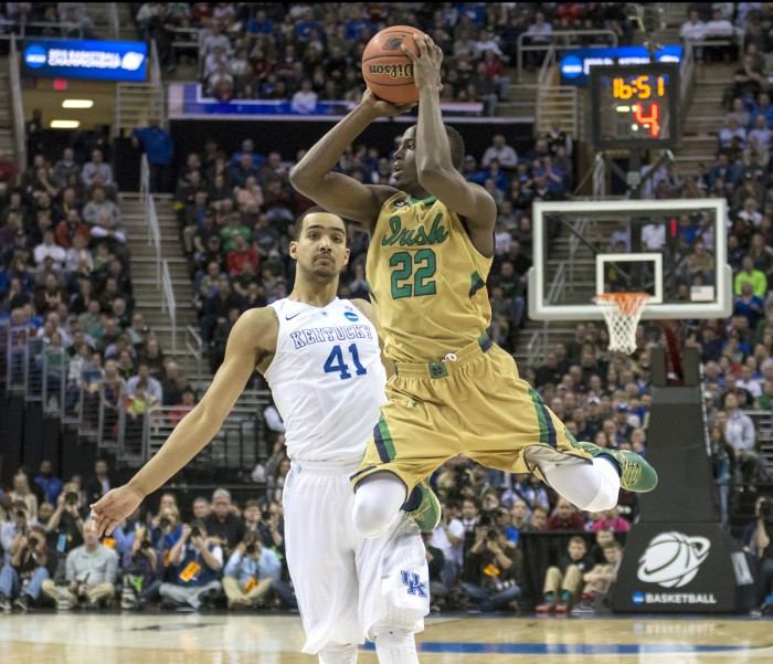 Irish senior guard Jerian Grant floats in the lane looking for a pass during Notre Dame's 68-66 loss to   Kentucky during their Elite Eight matchup March 28.  Grant finished with 15 points and six assists.